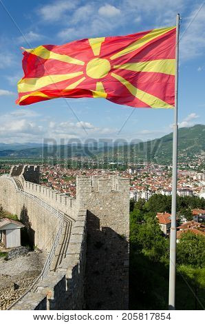 Walls and towers of Samuel's fortress with waving Macedonian flag, Ohrid, Macedonia