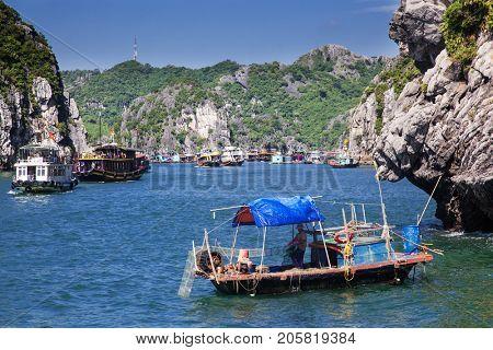 CAT BA, VIETNAM - JULY 2017: Floating village in Ha Long bay, nar Cat Ba island, Vietnam
