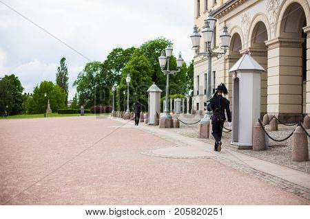 Oslo, Norway - June 08, 2017 : Royal Guard guarding Royal Palace in Oslo Norway