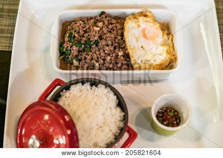 Stir fried beef with basil and steamed rice and fried egg