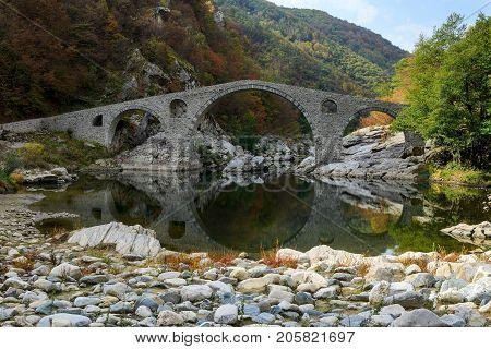 Autumnal tranquil scenery of Devil Bridge (Dyavolski Most) footbridge in Rhodope mountain, Bulgaria