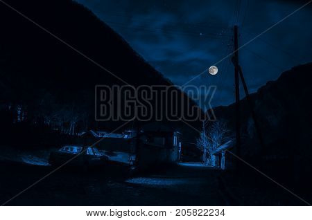 Mountain River With Stones And Grass In The Forest At The Foot Of Mountain Slope At Night In Moon Li