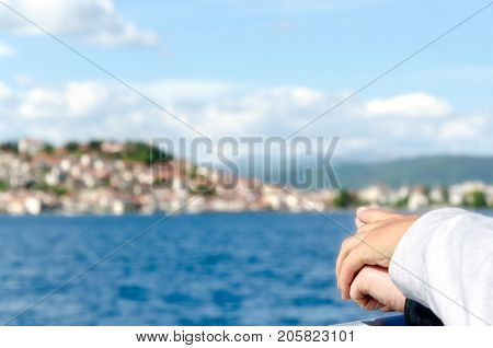 Couple in love holding hands and pointing to their next travel destination, island or shoreline