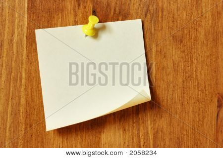 Single blank note paper attached to a wooden wall poster