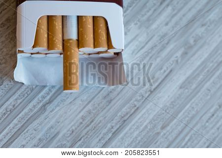 Open Cigarettes In Pack And Tobacco , Close Up. Stop Smoking. World No Tobacco Day. Cigarette With B