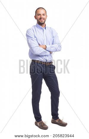 Young business man standing with arms crossed on a white background