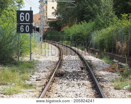 railway railroad tracks for train public transport and speed limit sign