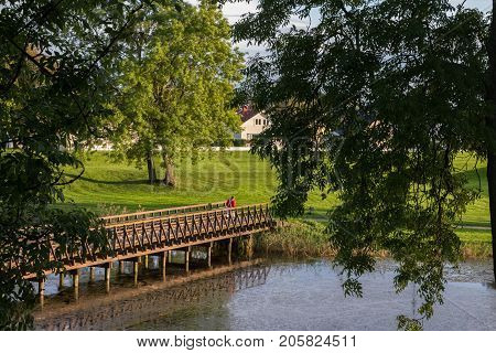 The Old Town in Fredrikstad, bridge over the moat. Green trees and grass. Norway