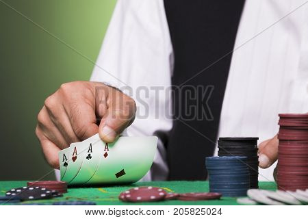 Poker player holding four aces cards in hand