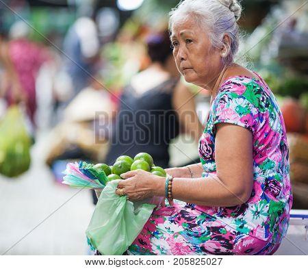 HO CHI MINH CITY (SAIGON), VIETNAM - JULY 2017 : Unidentified vendor at Ben Thanh market in Saigon, Ho Chi Minh City, Vietnam