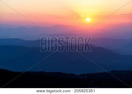 Inspiring natural background - sunset over the hazy mountains, Vitosha national park, Bulgaria