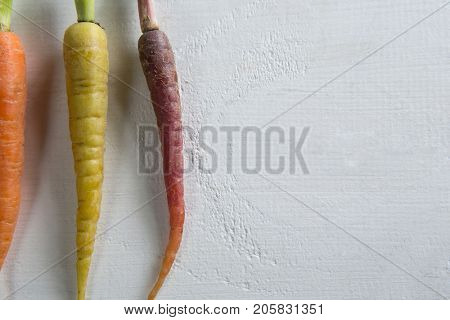Overhead view of carrots arranged side by side
