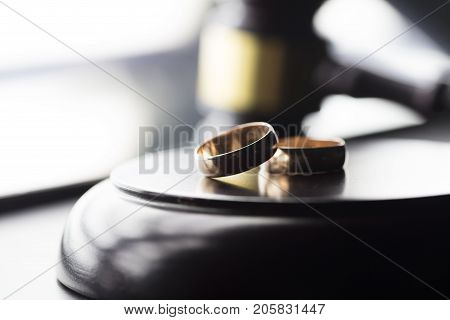 Divorce law concept. Wedding ring and gavel.