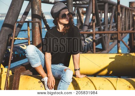 Model wearing plain black t-shirt and hipster sunglasses, teen urban clothing style, mockup for tshirt print store