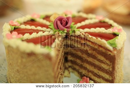 Decorated sweet chocolate layers cake on table