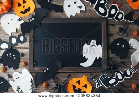 Halloween candy corns with pumpkins ghosts and spiders on wooden table