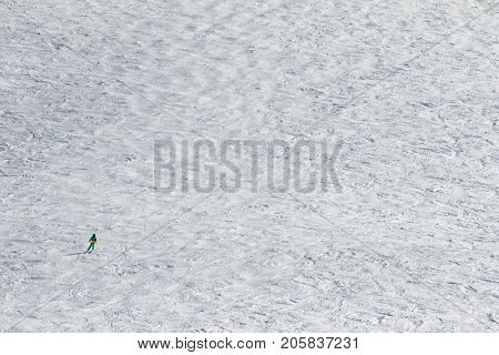 Skier Downhill On Snow Slope