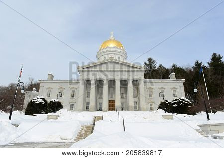 Vermont State House in winter, Montpelier, Vermont, USA. Vermont State House is Greek Revival style built in 1859.
