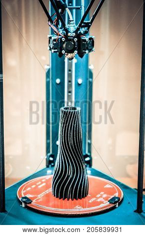The model object printed on the 3d printer is inside the 3d printer close-up. Progressive modern additive technologies 4.0 industrial revolution