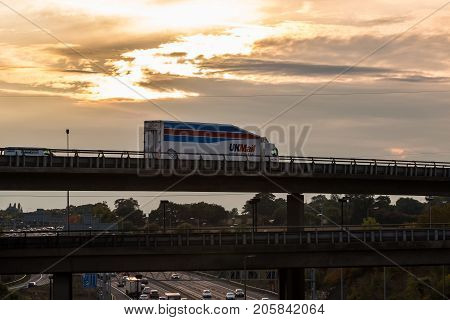 London UK - September 21 2017: Uk Mail lorry on the viaduct over British motorway M25 during sunset