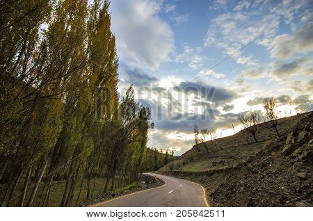 Cycling Mountain Road. Misty Mountain Road In High Mountains. Cloudy Sky With Mountain Road. Azerbai