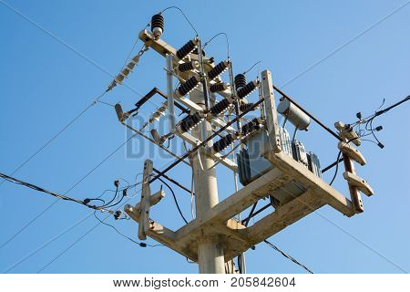 small transformer on the electric pole. city mains electricity
