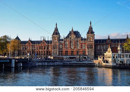 AMSTERDAM, NETHERLANDS - MAY 9, 2017: Amsterdam Centraal station is the largest railway station of Amsterdam and major national railway hub. The Gothic Renaissance Revival building was built in 1889