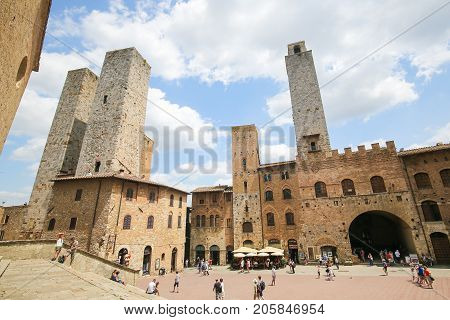 SAN GIMIGNANO ITALY - JULY 11 2017: Medieval Towers including the famous Torre Chigi in San Gimignano the Town of Fine Towers in Tuscany Italy