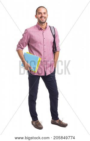 Smiling student standing with textbooks and backpack on white background