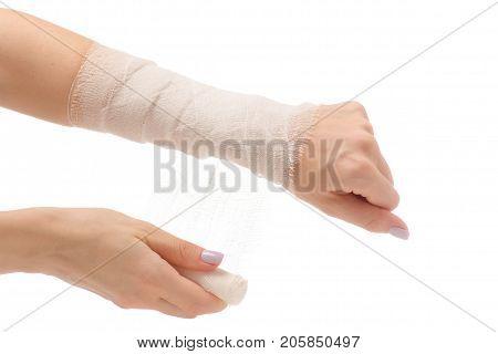 Female hand with a bandage injury on a white background isolation