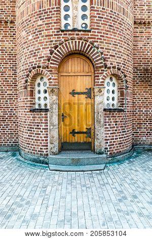 Orthodox church wooden back door brick exterior