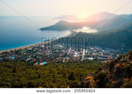 Oludeniz beach and small town of Oludeniz, view from mountain during sunset