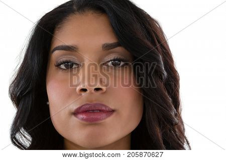 Close up portrait of young woman against white background