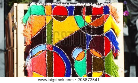 A carpet with an abstract pattern made by hands. Souvenirs and visual arts are sold at a street fair in Nalchik.