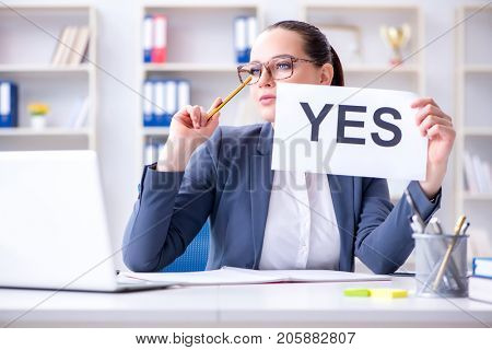 Businesswoman with yes message in office
