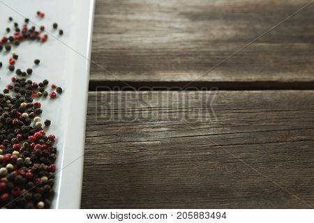 Close-up of mix peppercorns in tray