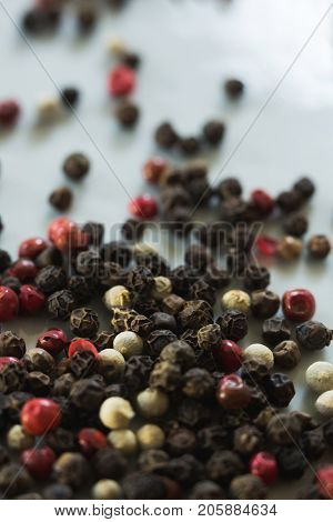 Close-up of mix peppercorns on white background