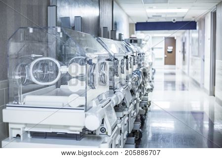 Newborn infant incubator boxes in a hospital corridor