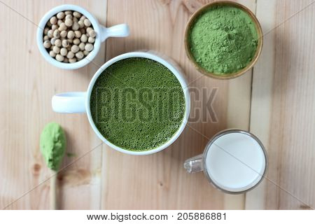 Top View,closes Up Hot Green Tea Matcha Latte. Decorate With Powder Extract And Soy Beans, Milk