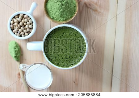Top View,closes Up Hot Green Tea Matcha Latte. Decorate With Powder Extract And Soy Beans, Milk.