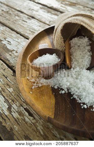 Close-up of sea slat on wooden plate