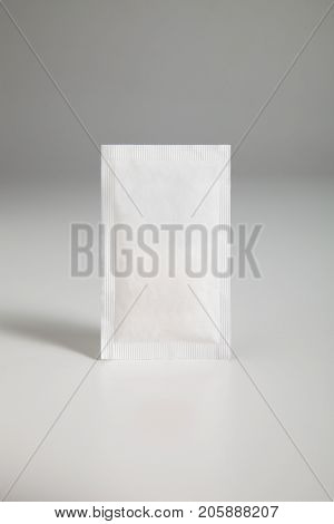 sugar sachet over gray background