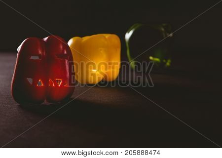 Close up of colorful carved bell peppers on table