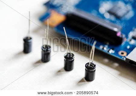 Closeup of capacitors electronics part isolated on white