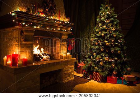 Living room home interior with decorated fireplace and christmas tree