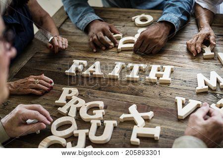 A wooden alphabet faith word on the table