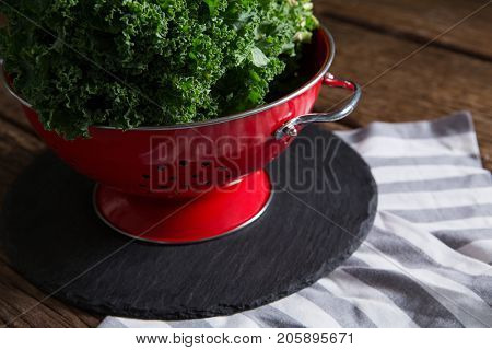 Close-up of mustard greens in strainer
