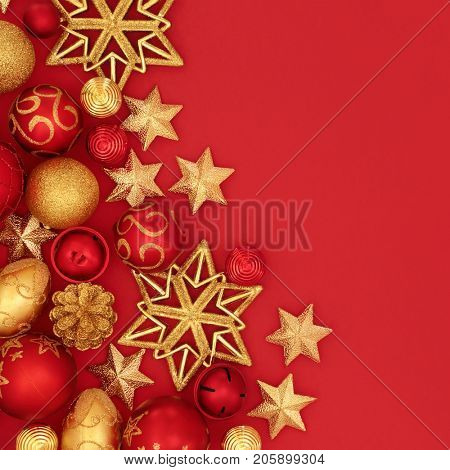 Festive christmas background border on red with bauble decorations.