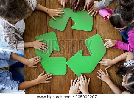 Environmental conservation children with recycle symbol