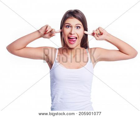 crazy young  woman showing toungue wearing jeans against white studio background
